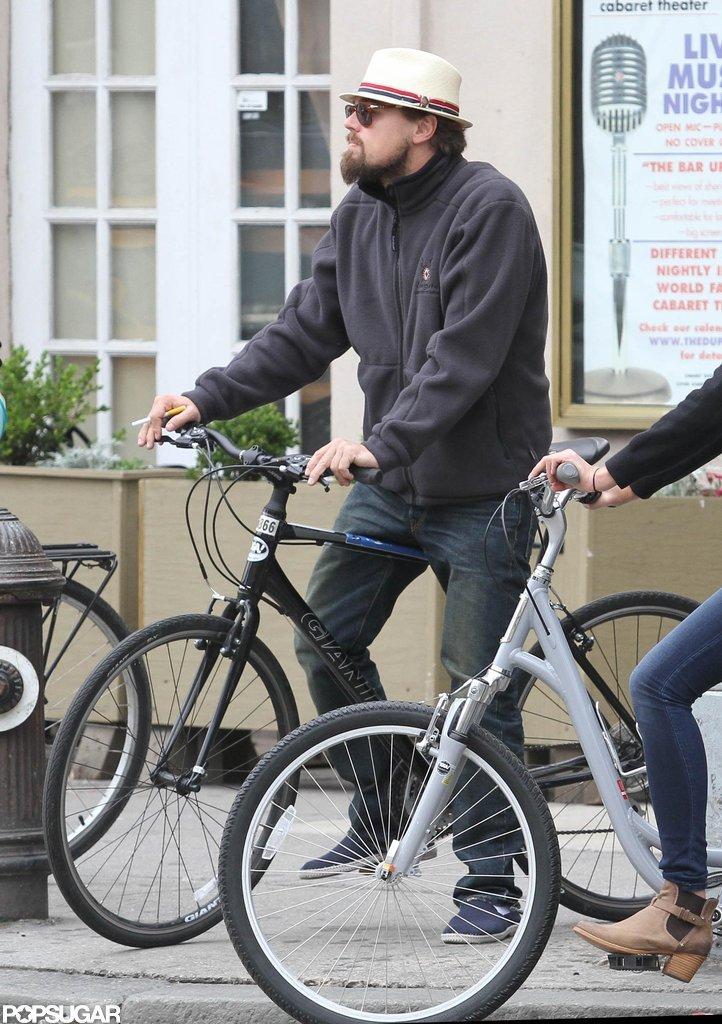 Leonardo DiCaprio wore a straw hat during a bike ride through NYC.
