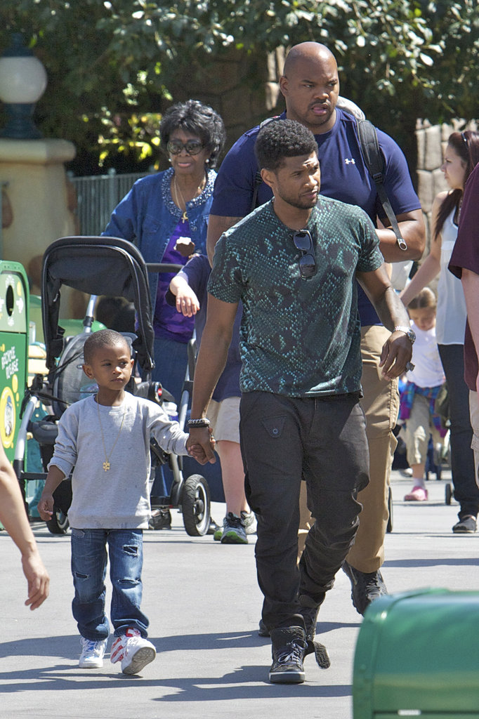 Usher took his kids to the theme park in April 2012.