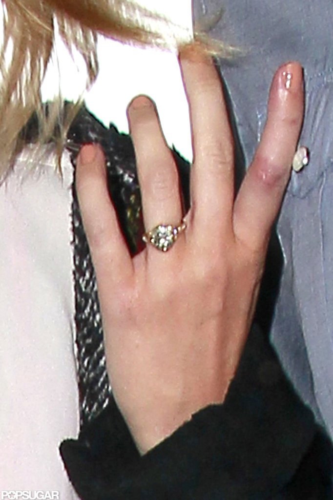 Miley Cyrus wore her engagement ring to catch a flight out of LAX.