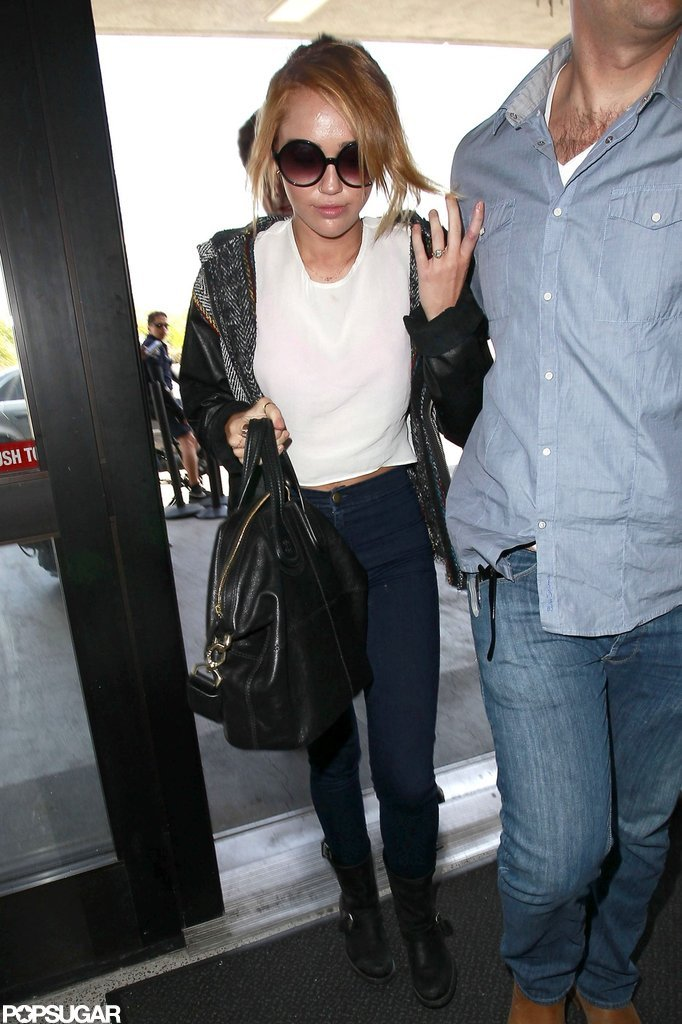 Miley Cyrus showed off her new engagement entering LAX.