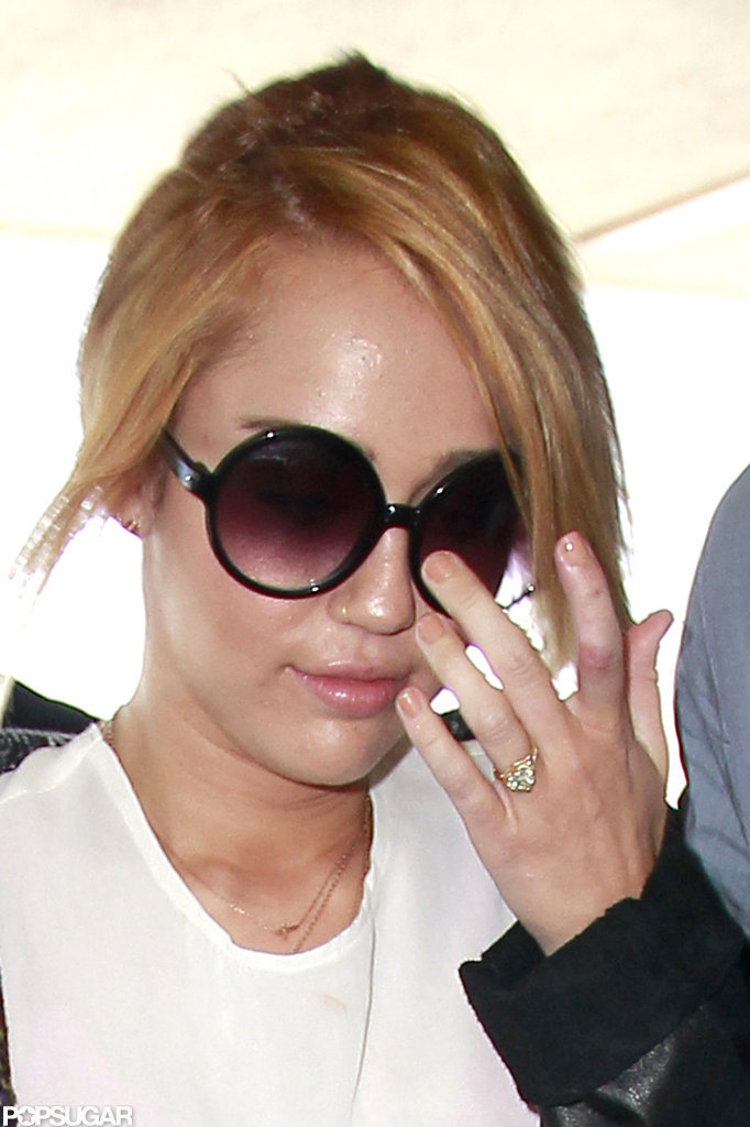 Miley Cyrus wore her engagement ring during her travels at LAX.