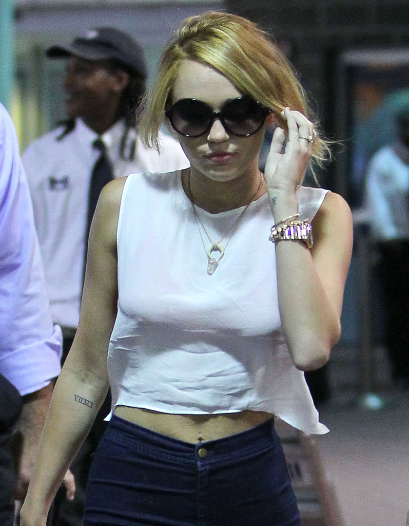 Miley Cyrus showed off her engagement ring as she arrived in New Orleans.