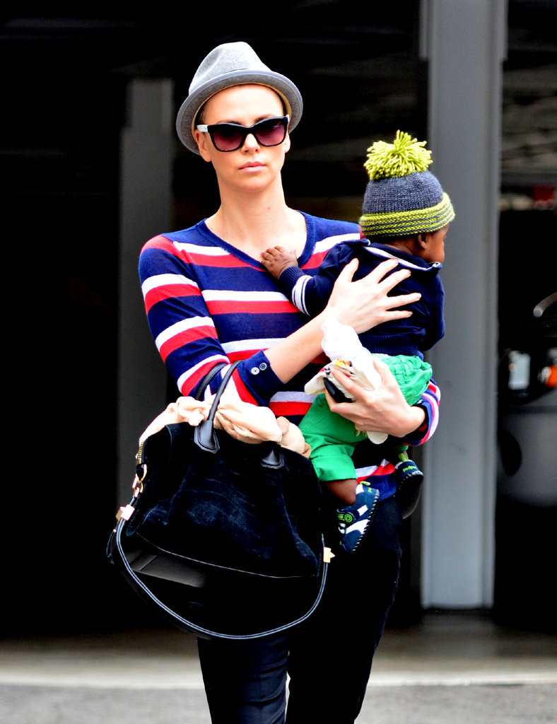 Charlize Theron shaved her head and was seen with son Jackson in California.
