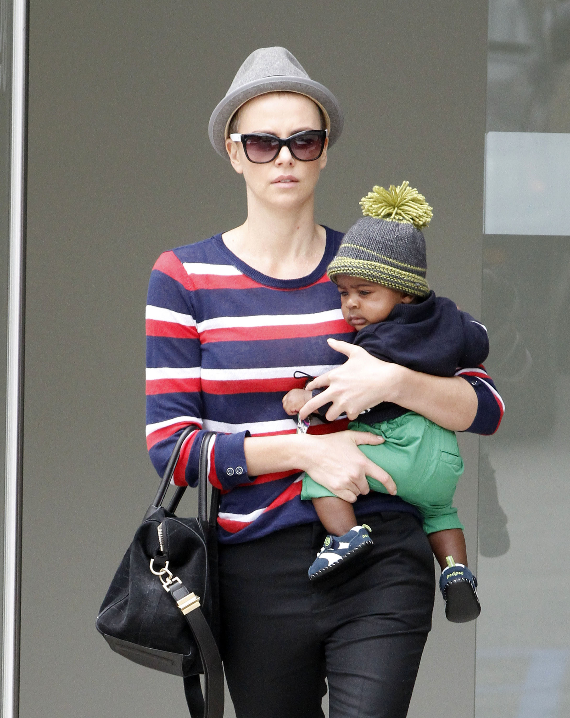 Charlize Theron wore a fedora and shades in Beverly Hills.