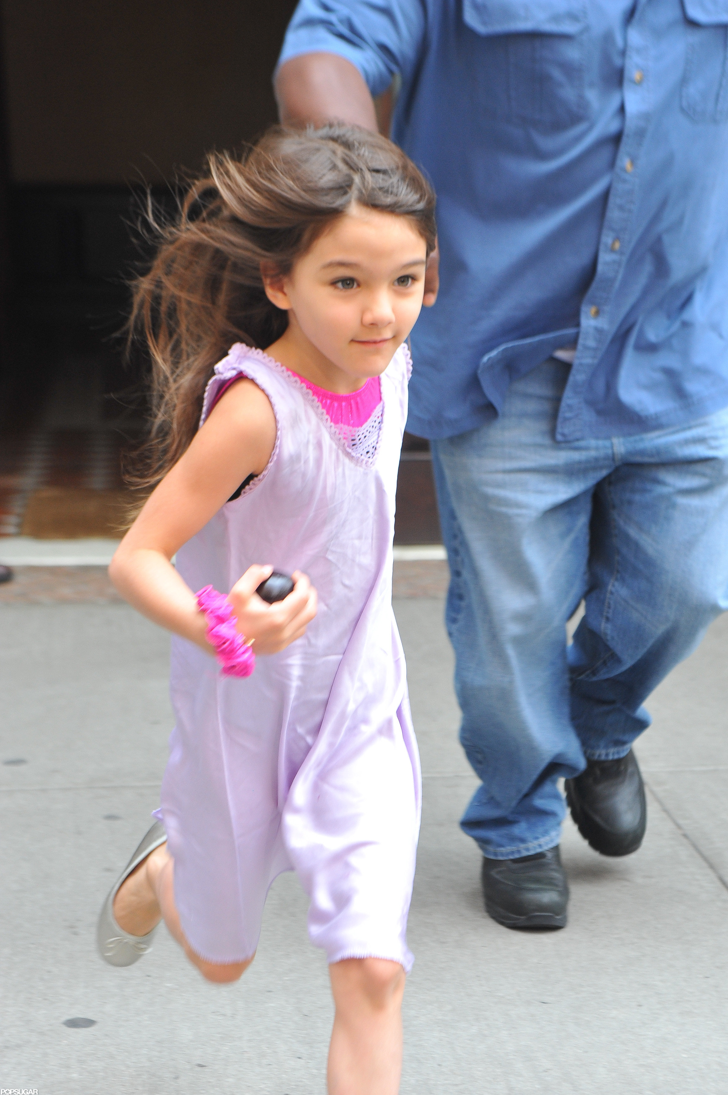 Suri Cruise ran for the car in NYC.