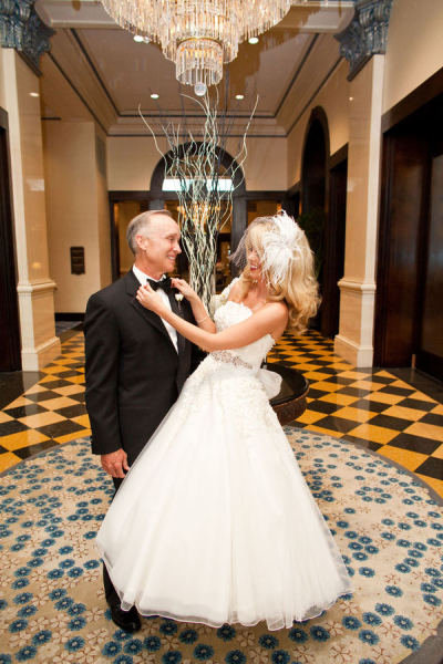 Too sweet! This bride adjusted her dad's suit for a cute photo op. Photo by Michelle Sullivan Photography via Style Me Pretty