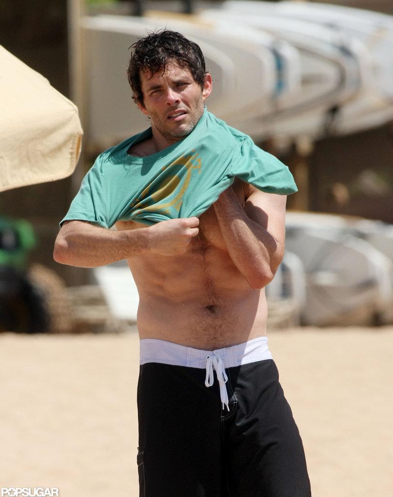 James Marsden put on a shirt on the beach in Hawaii.