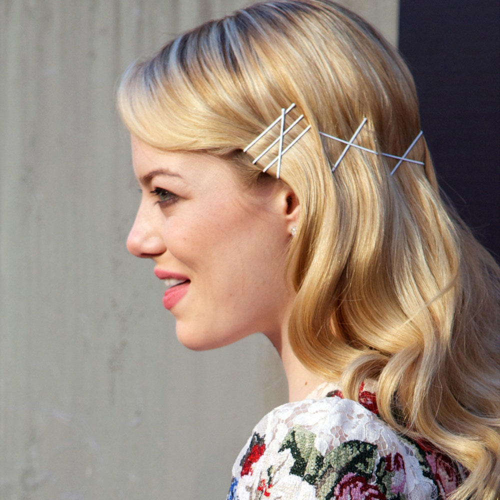 Emma Stone's cute clip hairstyle at the Madrid premiere of The Amazing Spider-Man was unique and something we haven't see before. You can recreate her look at home using any type of hair pins, but we love black for a sleek evening look. Try 999 Black Bobby Pins ($16.95).