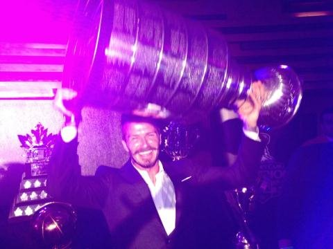 David Beckham flashed a huge smile while holding the Stanley Cup. Source: Twitter user victoriabeckham