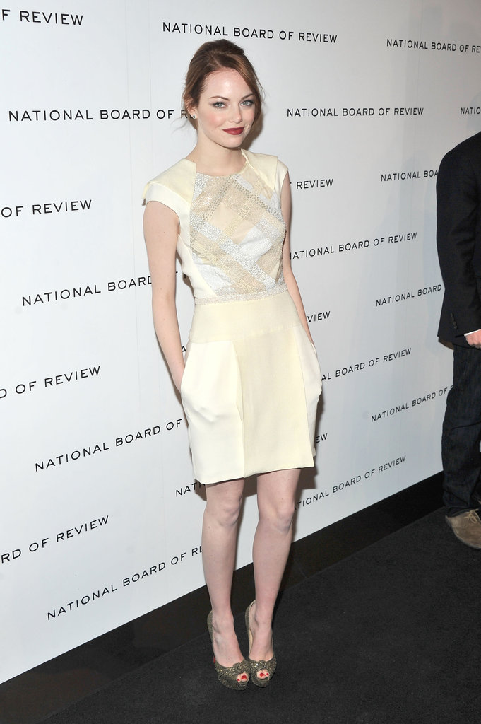 For the 2011 National Board of Review Awards, Emma wore a cream-colored J. Mendel dress with Christian Louboutin peep-toe pumps.