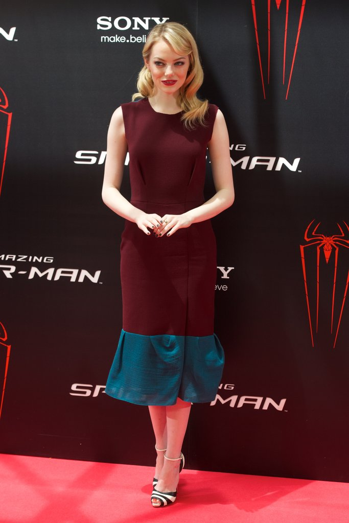 Emma looked impossibly polished in this darker two-toned Roksanda Ilincic dress and striped Christian Louboutin sandals at the Madrid photocall.