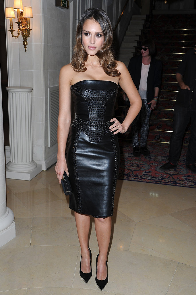 Jessica Alba wore a black leather dress to the Versace show for Paris Fashion Week.