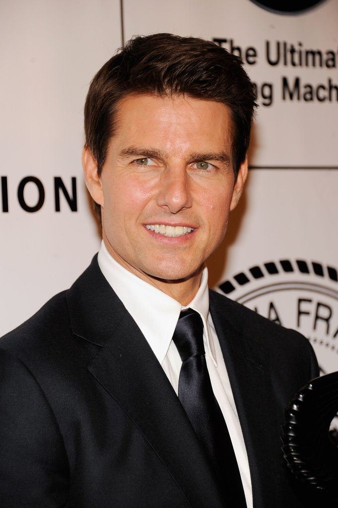 Tom Cruise looked dapper in a suit to accept an award from the Friars Club in NYC in June 2012.