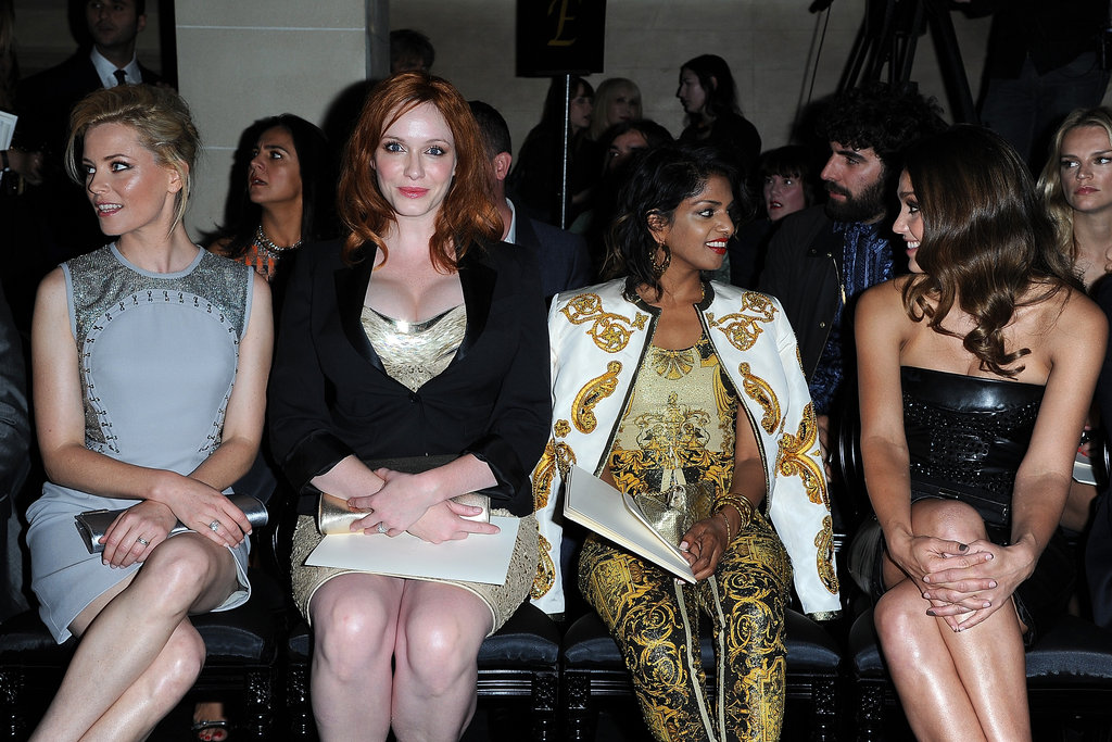 Elizabeth Banks, Christina Hendricks, M.I.A.. and Jessica Alba sat together front row at the Versace fashion show in Paris.