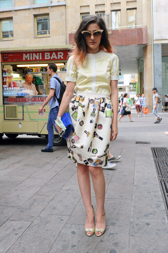 Eleonora Carisi outside the Moschino Men's Spring 2013 show in Milan.