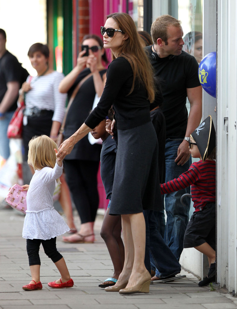 Vivienne Jolie-Pitt and Knox Jolie-Pitt were dressed up for an outing in Surrey, England, with mom Angelina Jolie in August 2011.