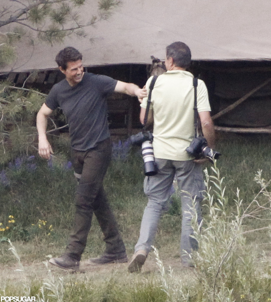 Tom Cruise gave a laugh on the set of Oblivion in June Lake, CA.