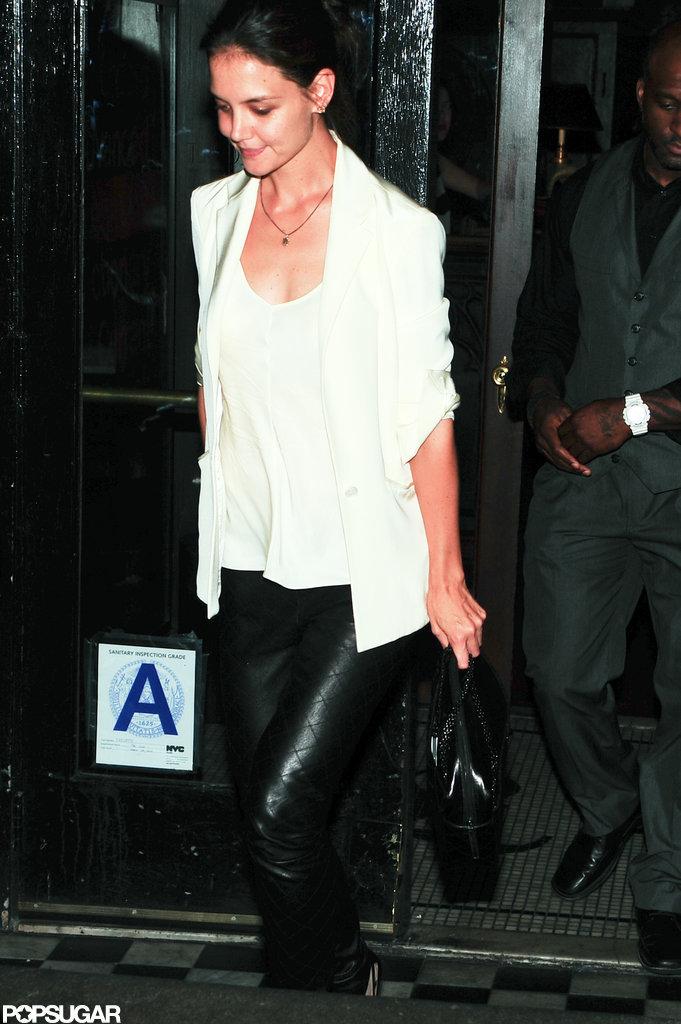 Katie Holmes wore black pants.