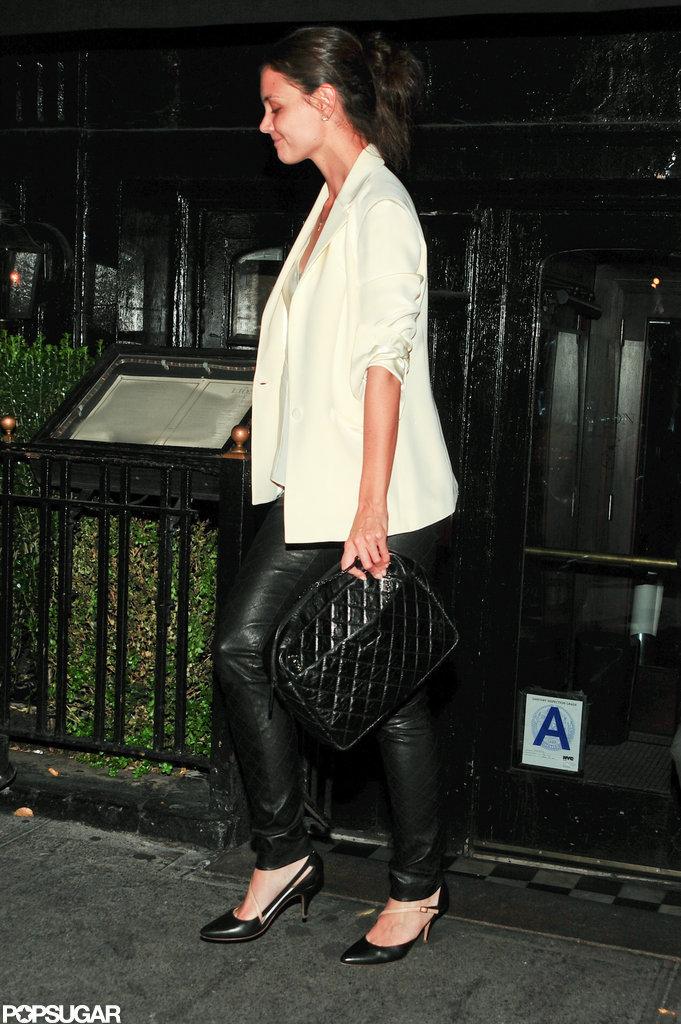 Katie Holmes carried a black clutch.