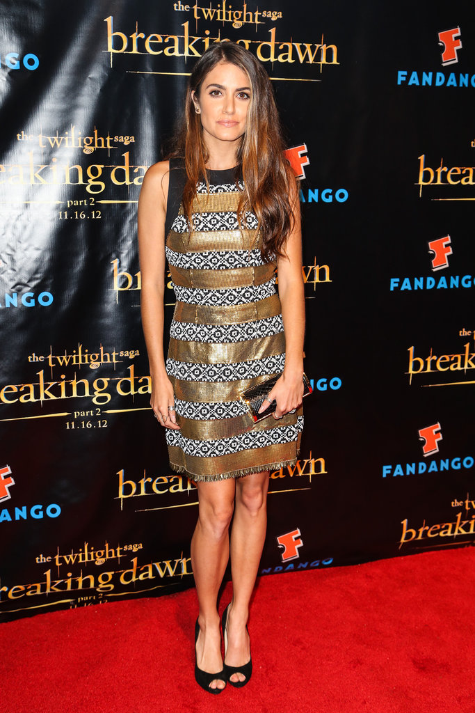 Nikki Reed pulled off this quirky metallic-meets-bold-prints Etro look with ease. To make sure the ensemble didn't overwhelm, she complemented her dress with sleek black peep-toe pumps and a gold snakeskin clutch.