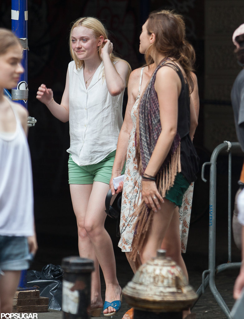 Dakota Fanning and Elizabeth Olsen shared a laugh on set.