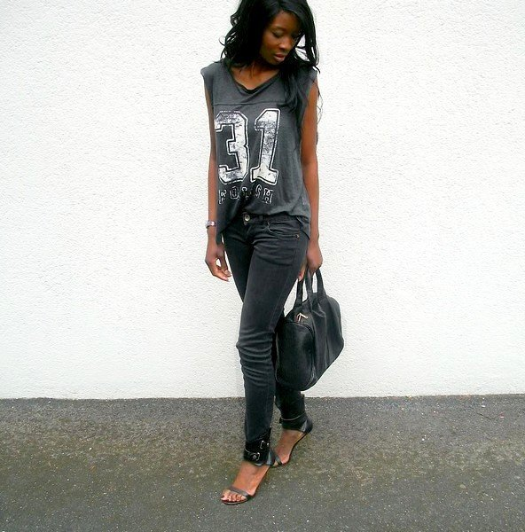 The pop of white, by way of vintage-looking jersey numbers, punches up this all-black outfit. Photo courtesy of Lookbook.nu