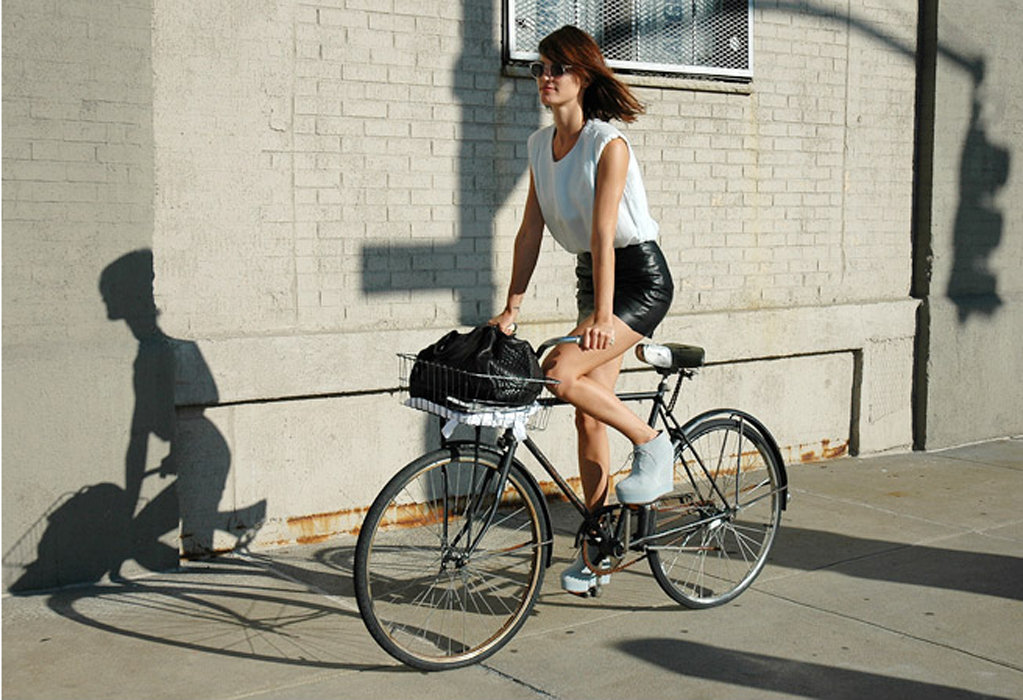 Show off your legs Hanneli Mustaparta-style in a formfitted black leather skirt, then tuck in a slouchy white tank — T by Alexander Wang has a great selection! — for a cool-girl finish. Photo courtesy of Lookbook.nu