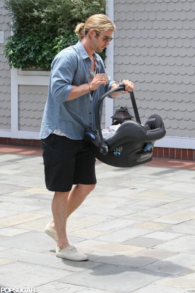 Chris Hemsworth carried his daughter India Hemsworth.