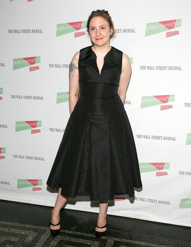 She wore a nipped-waist, tea-length black dress to the Nobody Walks premiere in June 2012.