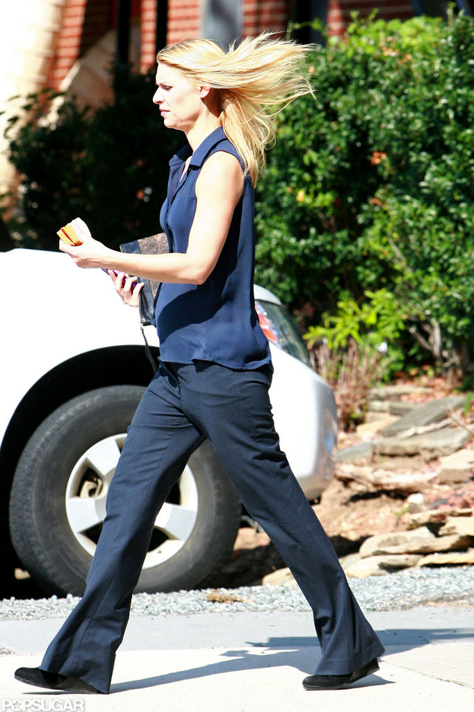 Claire Danes looked casual in a sleeveless button-down shirt and loose pants.