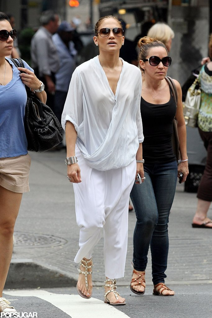 Jennifer Lopez walked through NYC in a white jumpsuit.