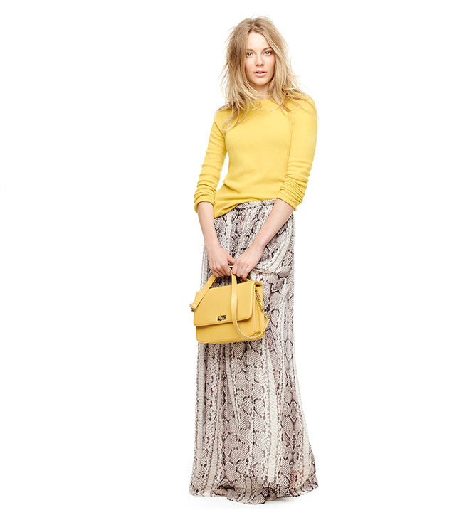 Looking for an update on the maxi? Switch up your Summer-style routine by warming up a floaty long skirt just like this, with a bold-hued knit on top.