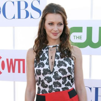 Katie Cassidy Wearing Red Skirt