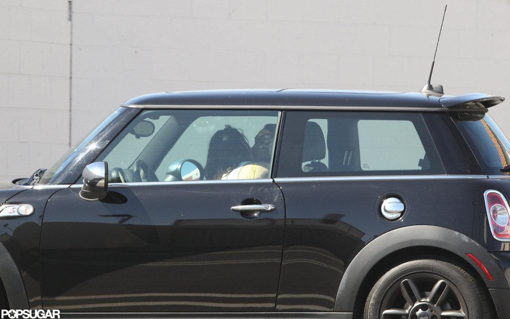 Kristen Stewart and Rupert Sanders pulled over in her Mini Cooper.