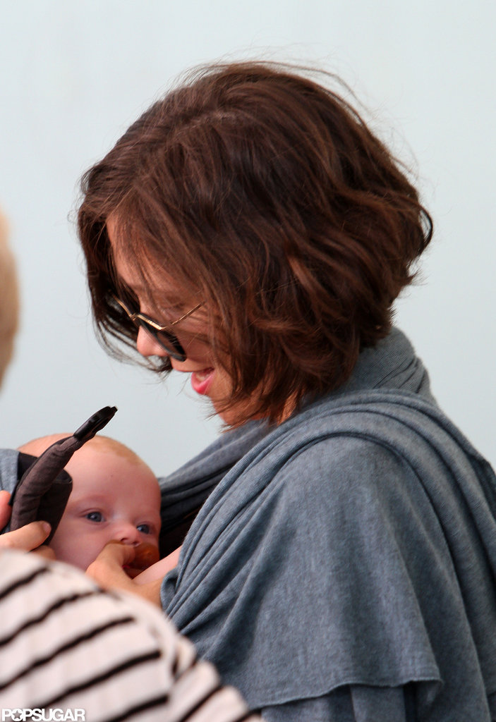 Maggie Gyllenhaal smiled down at sweet baby Gloria Sarsgaard in NYC.