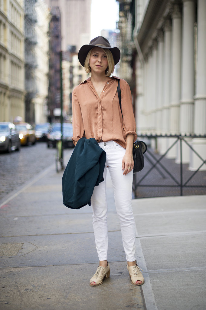 Don't fear the styling impact of a cool hat — this one lends a sweet tomboy feel to her basics. Source: Adam Katz Sinding