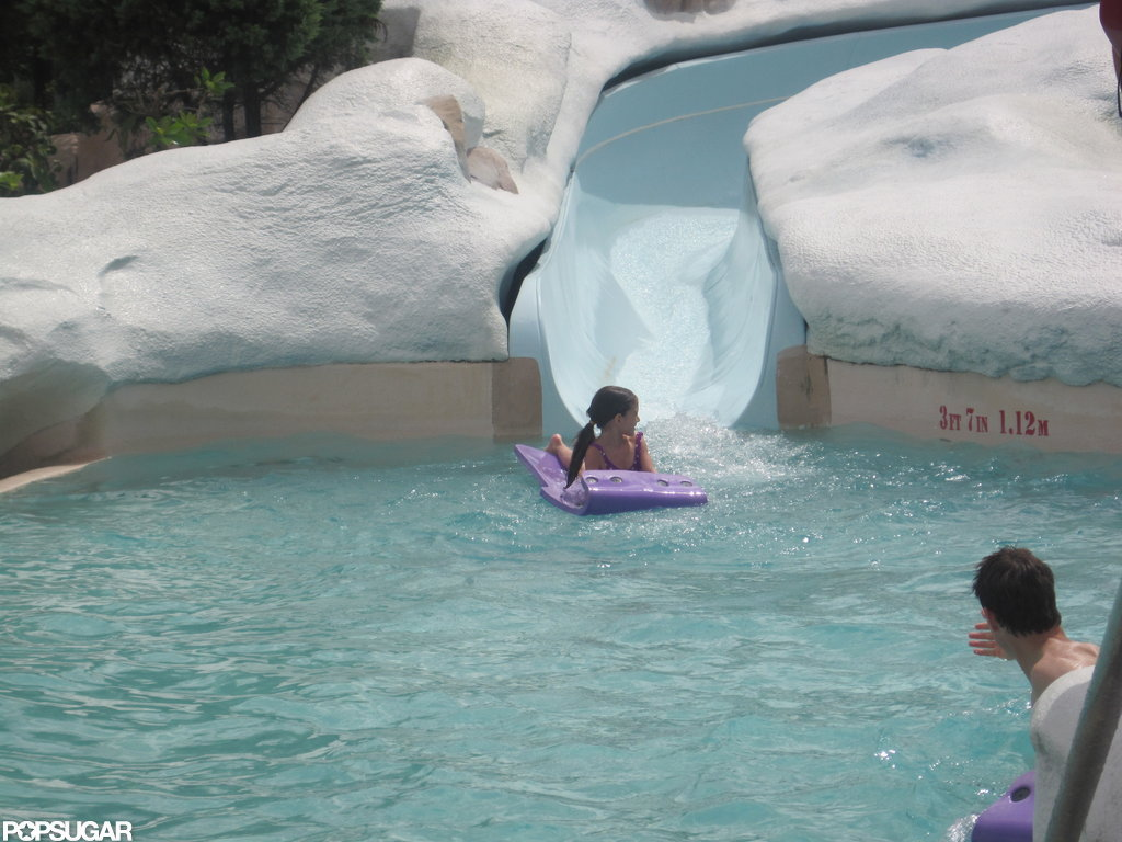 Shirtless Tom Cruise Splashes Around at a Water Park With Suri