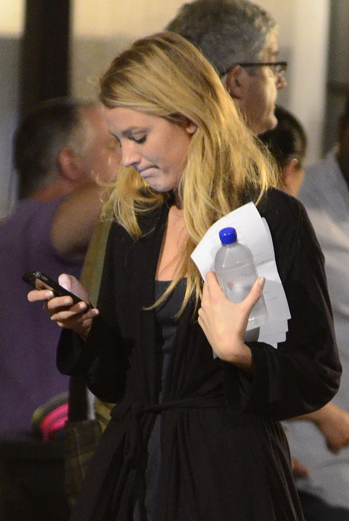 Blake Lively checked her phone during a break.