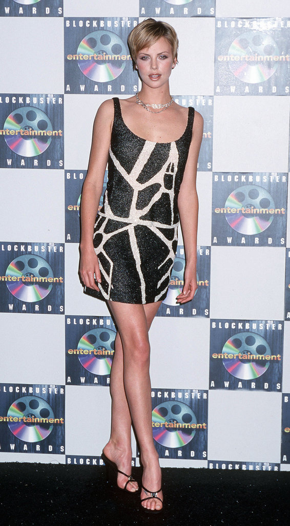 Charlize showed off her mile-long legs in a fitted minidress at the Blockbuster Awards in May 2000.