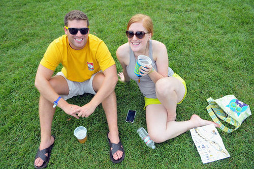 This couple of music fans sat on the grass together at Yeatman's Cove Park in Cincinnati, OH.