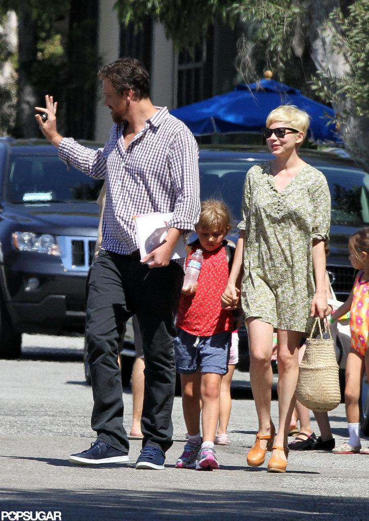 Michelle Williams and Matilda followed behind Jason Segel in LA.
