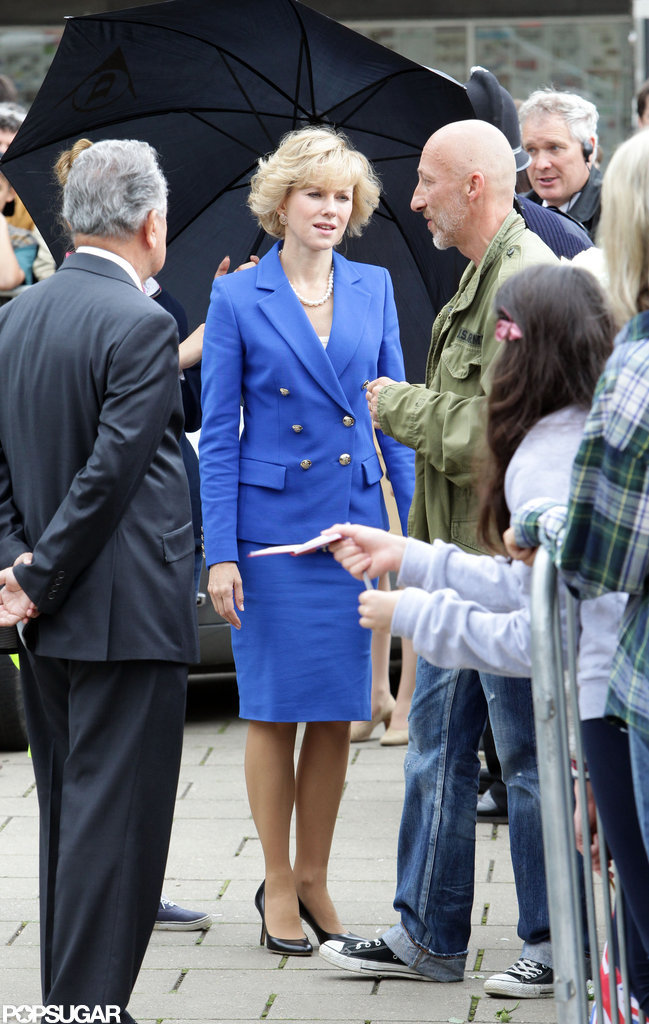 Naomi Watts filmed as Princess Diana in a blue suit.