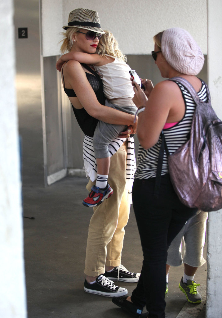 Gwen Stefani got off of the plane in LAX holding Zuma in her arms.