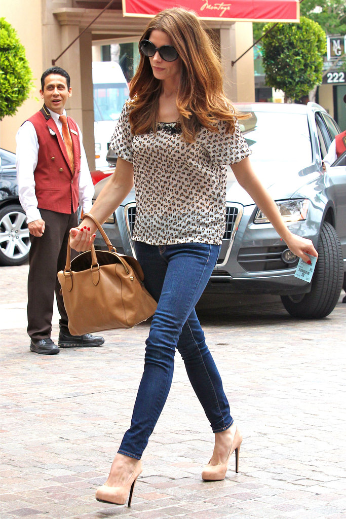 Ashley Greene gave her jeans a sophisticated twist with a printed top and heels.