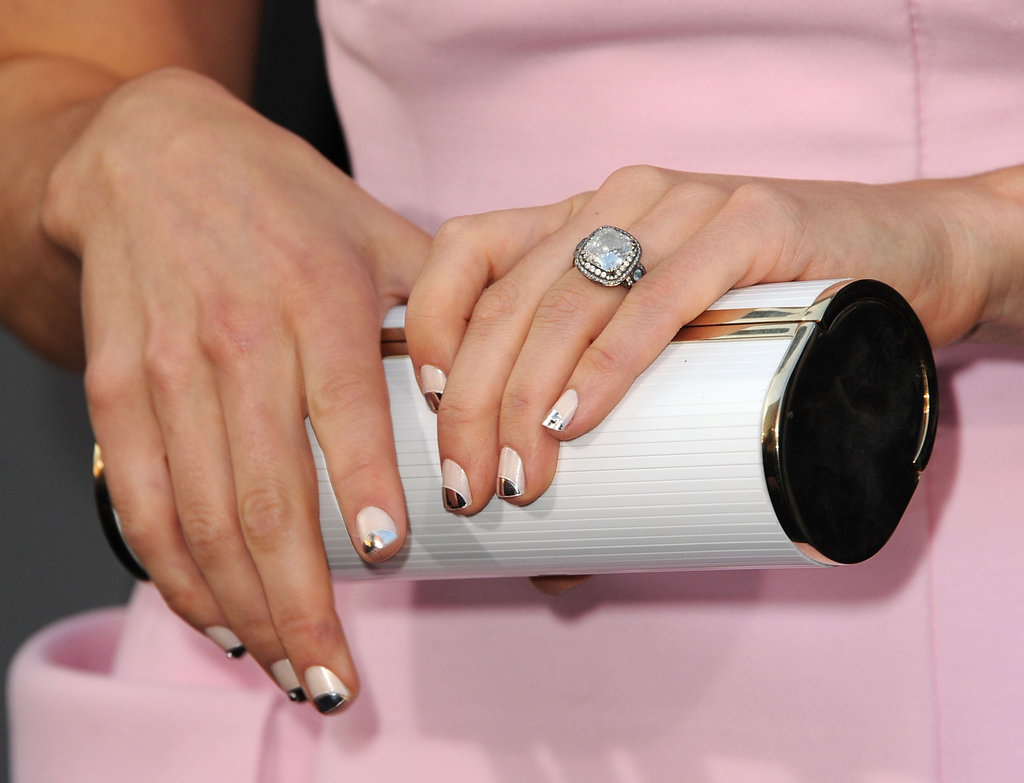 She paired a slim white Jimmy Choo clutch with her pretty-in-pink ensemble at the LA premiere of Total Recall.