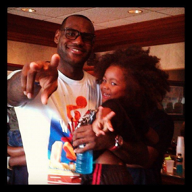 LeBron James hung out with a little fan.  Source: Instagram user kingjames