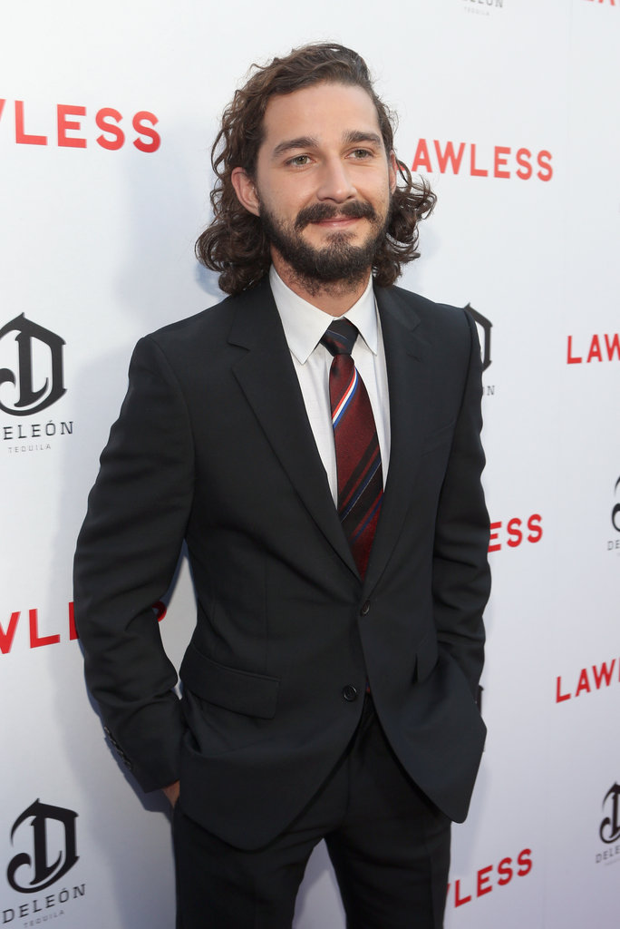 Shia LaBeouf looked handsome in a black suit and red patterned tie.