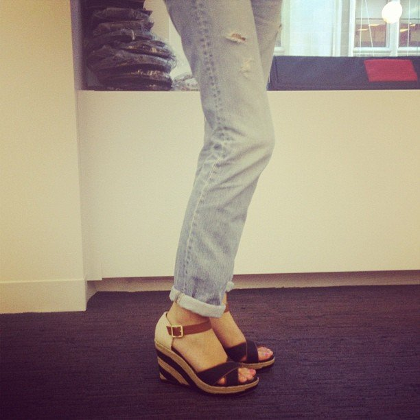 Associate editor Marisa Tom took on laid-back cool in a pair of distressed jeans and woven wedges.