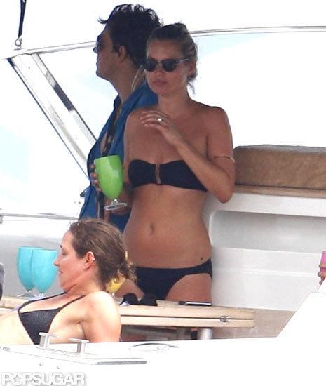 Kate Moss wore a black bikini with a bandeau top on a boat.