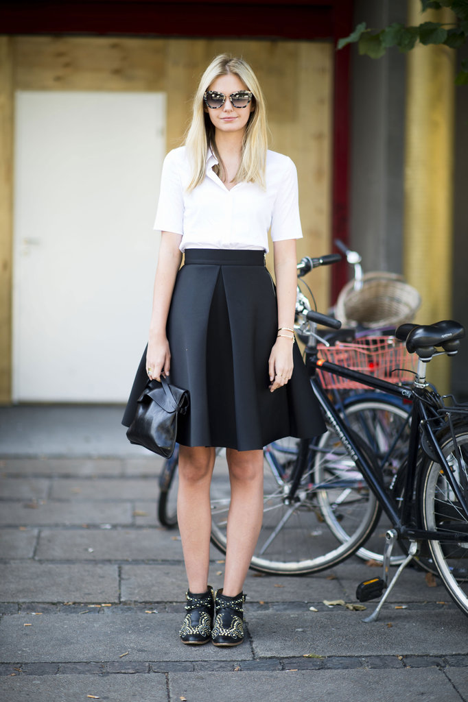 We can't get enough of this ladylike-turned-edgy style pro in a full skirt and a studded Chloé booties. Source: Adam Katz Sinding